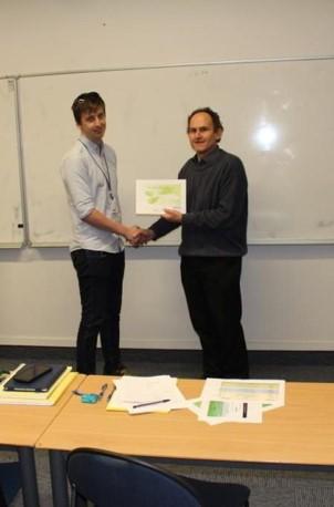 Matthew Lofroth accepts the runner up award for his micro-gripper development work