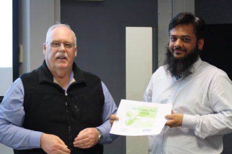 Muhammad Rehan accepts the runner-up award for his micro-gut capsule development work.