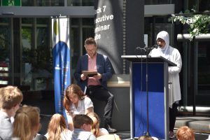 Professor Chris Gallavin (left) with Fatimah Khan, from Newlands College, reading her creative writing in 2018. She is a finalist this year too.